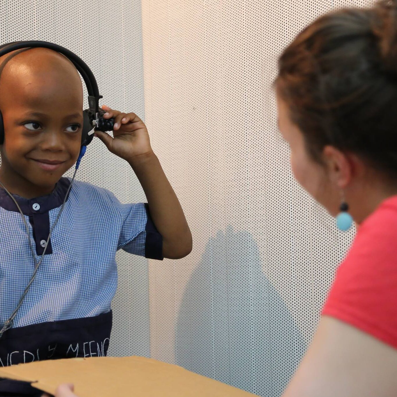 audiology boy with head phones testing